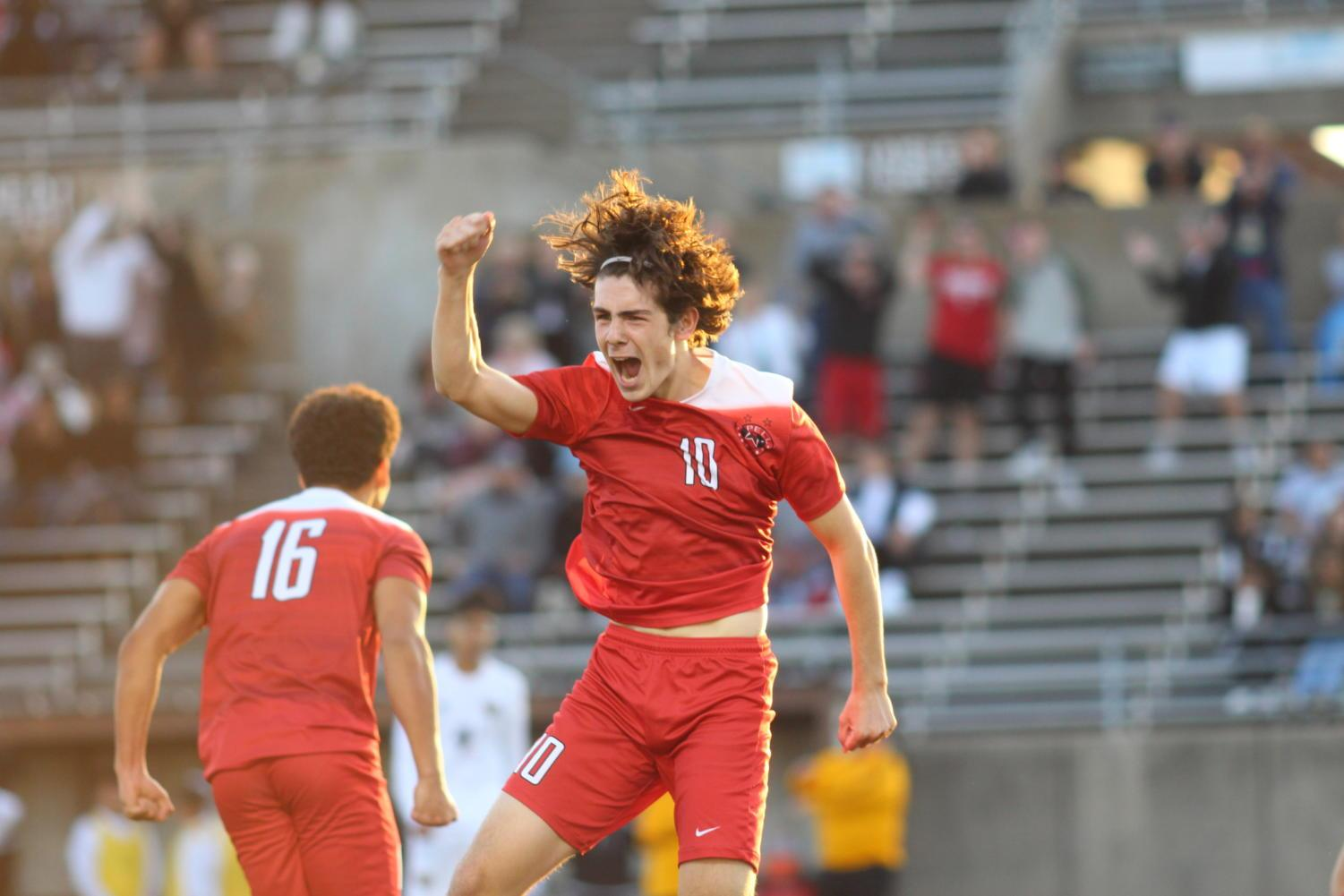 Coppell Cowboys senior midfielder Wyatt Priest jumps with joy after assisting a goal during the second half of the game on March 30 at John Clark Stadium in Plano. The Coppell Cowboys defeated the Garland Owls, 4-0, in the bi-district round of the Class 6A Region I playoffs.