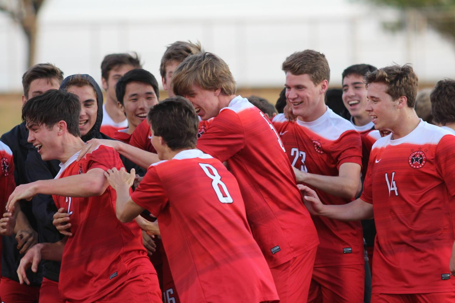 The Coppell Cowboys celebrate after senior fullback defender Marshall Board made a goal during the second half of the game on March 30 at John Clark Stadium in Plano. The Coppell Cowboys defeated the Garland Owls, 4-0, in the bi-district round of the Class 6A Region I playoffs.