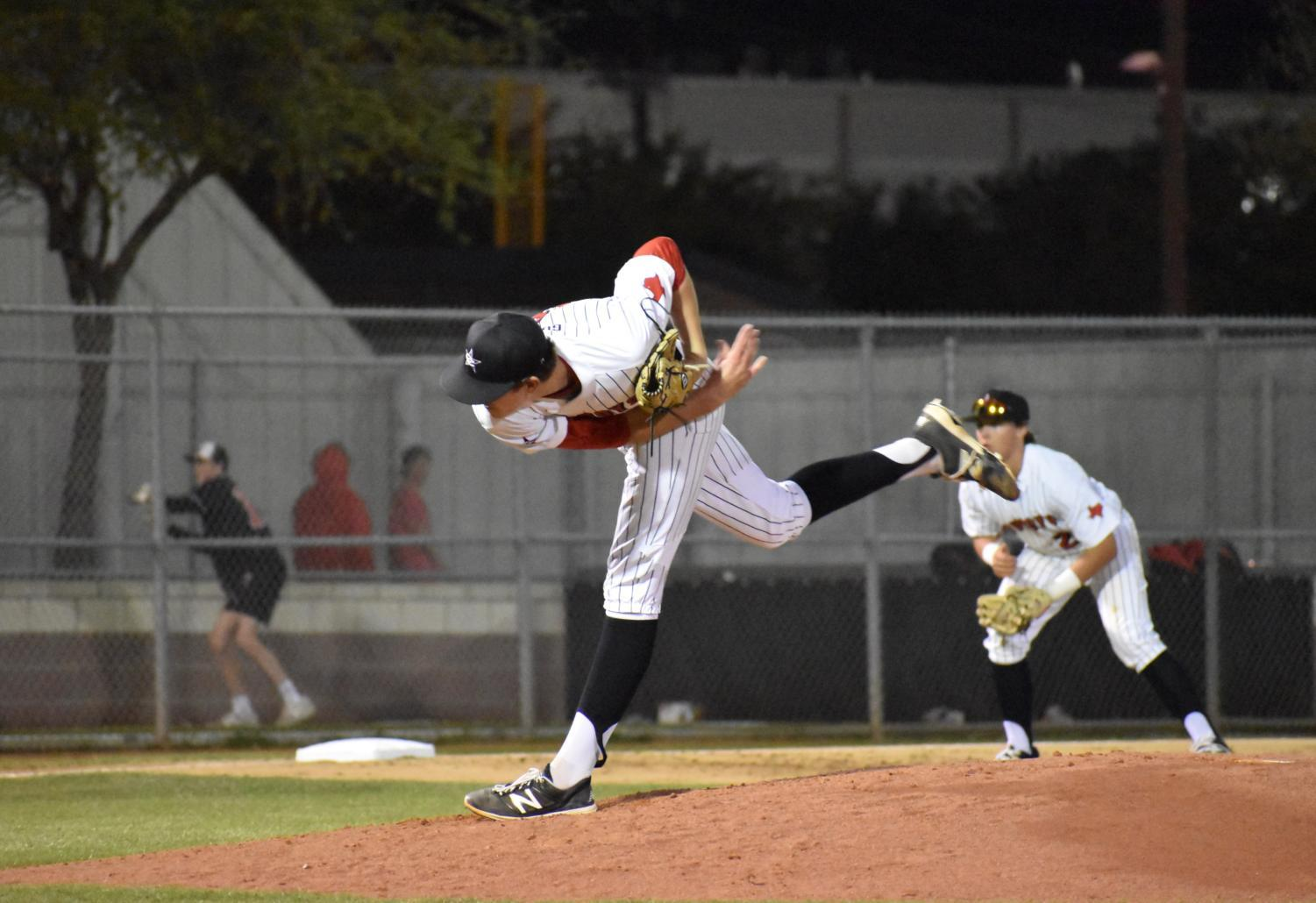 Coppell senior pitcher Rye Gunter delivers the next pitch to a Lake Highlands batter during Monday night's game at the Coppell Baseball/Softball Complex. The first game in the series against the Wildcats resulted in a 4-1 win for the Cowboys.