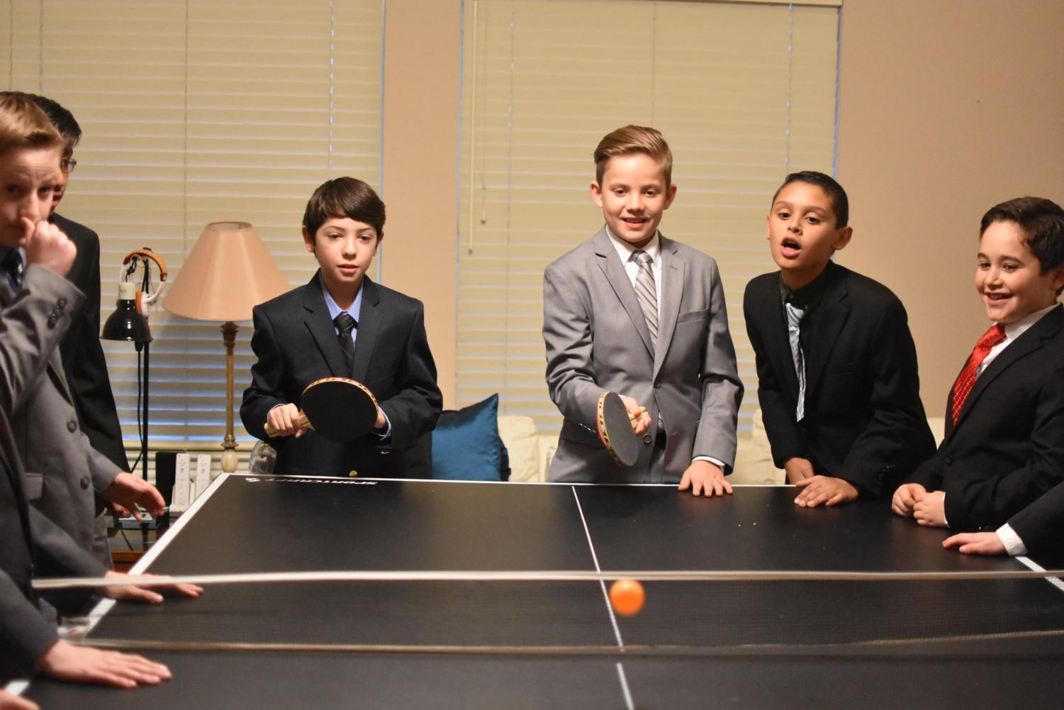 Lakeside+Elementary+students+play+ping+pong+on+Feb.+23+before+Friday+night+Cotillion+to+have+snacks+and+interact+with+each+other+along+with+parents.+Cotillion+is+a+class%2C+typically+for+elementary+or+middle+school+kids%2C+in+which+they+learn+basic+table+manners%2C+social+manners+and+formal+dances.