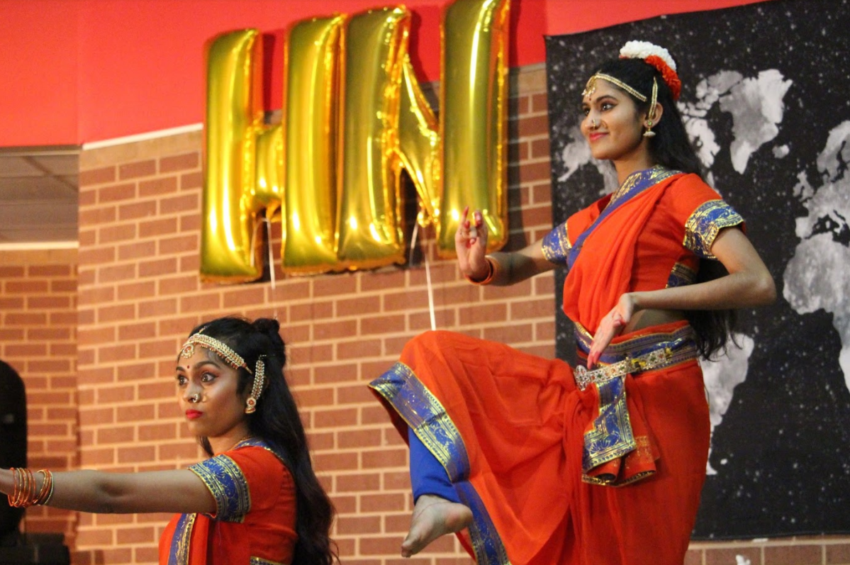 Coppell High School senior Shruti Asodaria and Frisco sophomore Sindhu Kavaru perform a classical Indian dance during Heritage Night on Friday, March 24 at the Coppell High School commons. Heritage Night is an annual event hosted by the Junior World Wide Affairs Council that enables students from various walks of life to share a piece of their culture through dance, song and other creative outlets.