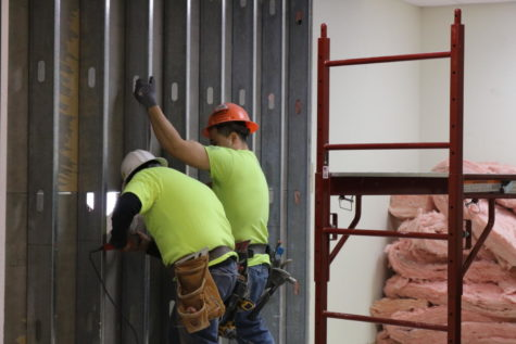Construction workers begin building the new security vestibule in the storage room of Coppell High School. Students and visitors will be required to check in through the vestibule once first period begins. These renovations will continue through the rest of spring break.