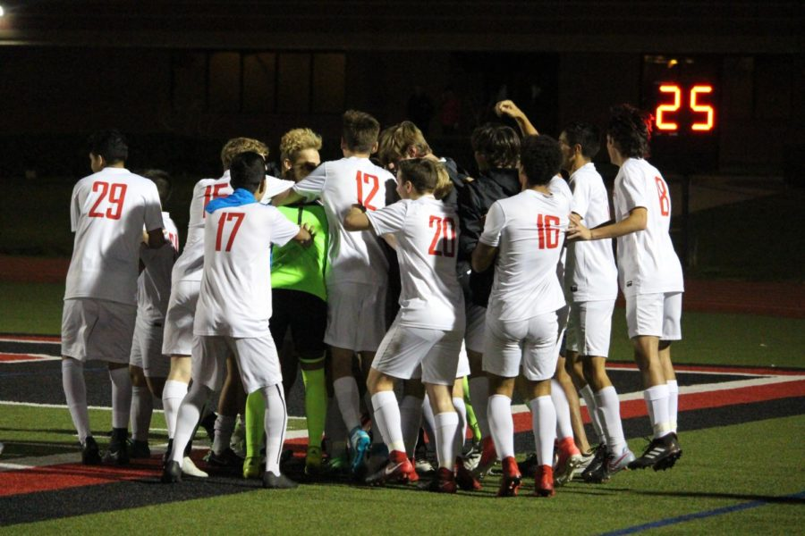 Coppell High School varsity boys celebrate after a goal made by junior forward Adam Marez during the first half of the game on senior night March 20 at Buddy Echols Field. The Cowboys won the game against the Raiders 6-0.