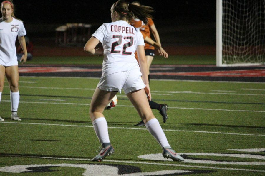 Coppell+High+School+freshman+Maya+Ozymy+runs+to+an+opening+during+the+first+half+of+Tuesday+nights+home+game+at+Buddy+Echols+Field.+The+varsity+girls+soccer+team+played+against+WT+White+taking+the+win+with+a+score+of+5-1.