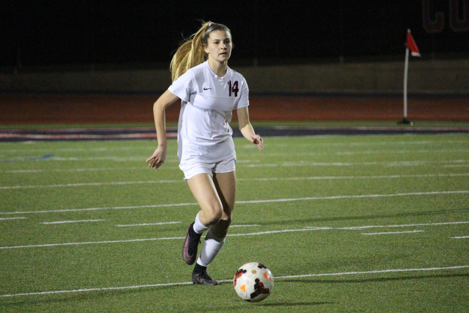 Coppell+High+School+senior+Addison+Ramirez+runs+with+the+ball+during+the+first+half+of+Tuesday+nights+home+game+at+Buddy+Echols+Field.+The+varsity+girls+soccer+team+played+against+WT+White+taking+the+win+with+a+score+of+5-1.