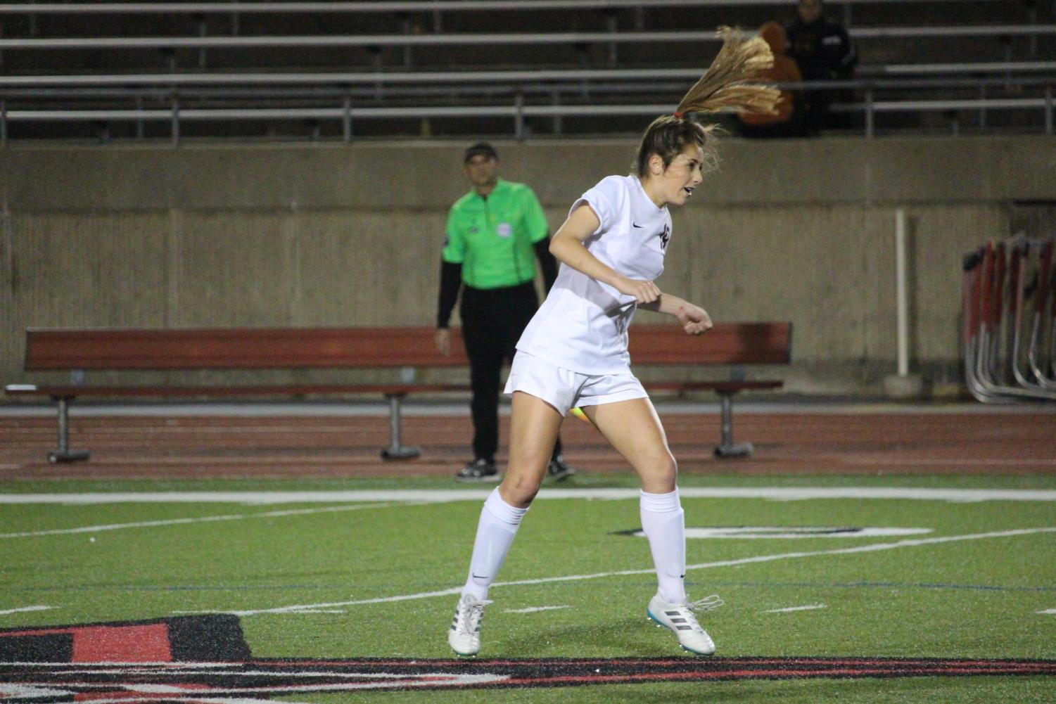 Coppell+High+School+sophomore+Montserrat+Lomeli+passes+the+ball+with+a+headbutt+during+the+first+half+of+Tuesday+nights+home+game+at+Buddy+Echols+Field.+The+varsity+girls+soccer+team+played+against+WT+White+taking+the+win+with+a+score+of+5-1.