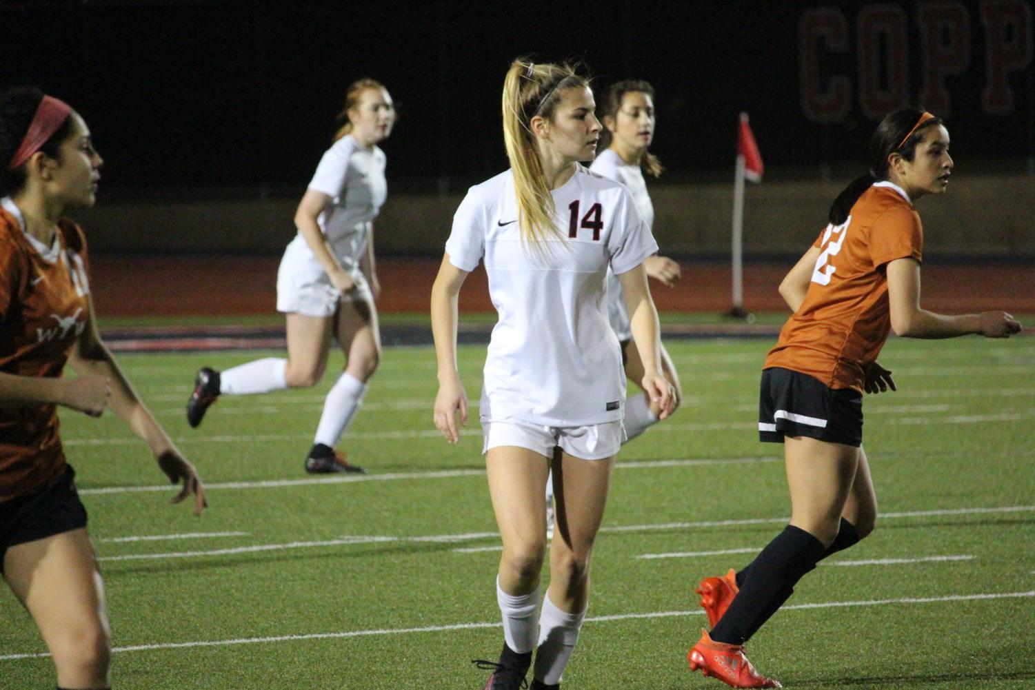 Coppell+High+School+senior+Addison+Ramirez+watches+the+ball+during+the+first+half+of+Tuesday+nights+home+game+at+Buddy+Echols+Field.+The+varsity+girls+soccer+team+played+against+WT+White+taking+the+win+with+a+score+of+5-1.