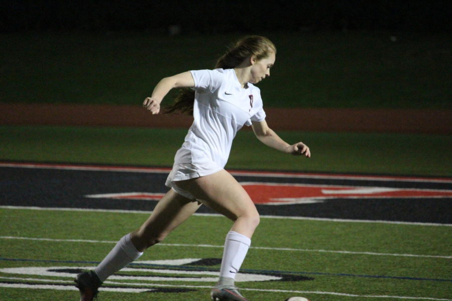 Coppell High School senior Rebecca Watley runs with the ball during the first half of Tuesday nights home game at Buddy Echols Field. The varsity girls soccer team played against WT White taking the win with a score of 5-1.