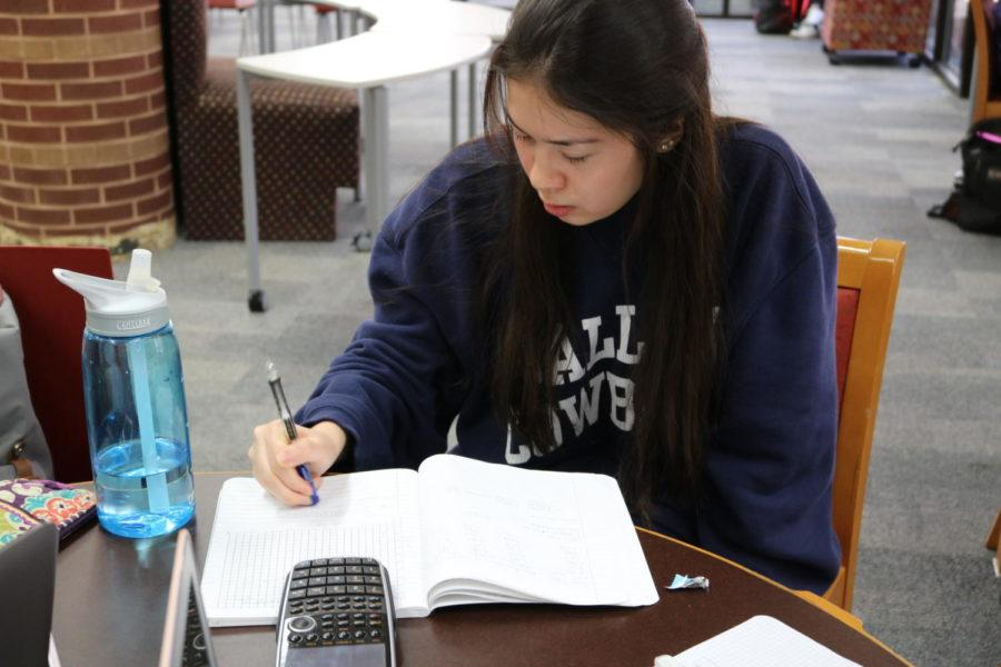 Coppell High School students often go to the library for a quiet space to study. Junior Sarah Singer is studying for her physics test during lunch on Friday where the library is often quiet at that time.