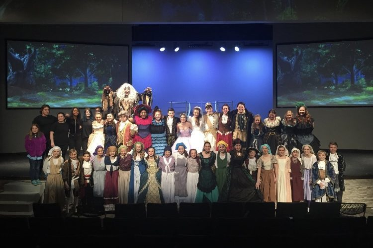 The+cast+of+the+First+United+Methodist+Church+Cinderella+production+poses+for+a+photo.+The+musical+was+performed+on+three+consecutive+days%2C+from+March+1+to+March+3.%0A