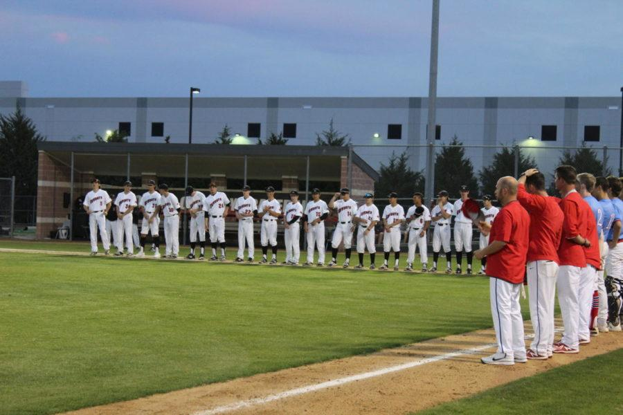 The Coppell High School varsity baseball team lines up before their game against JJ Pearce Mustangs at the Coppell Baseball/Softball Complex on Friday . The Cowboys defeated the Mustangs with a score of 7-1.