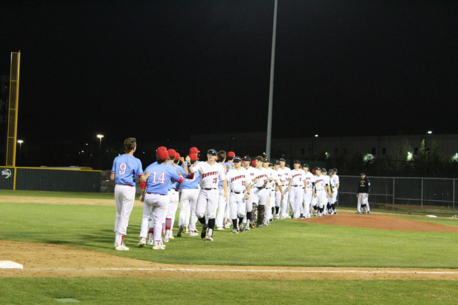 The+Coppell+Cowboys+Baseball+team+shakes+hands+with+the+JJ+Pearce+Mustangs+after+Friday+night%E2%80%99s+game+at+the+Coppell+Baseball+%2F+Softball+Complex.+The+Cowboys+defeated+the+Mustangs+with+a+score+of+7-1.+