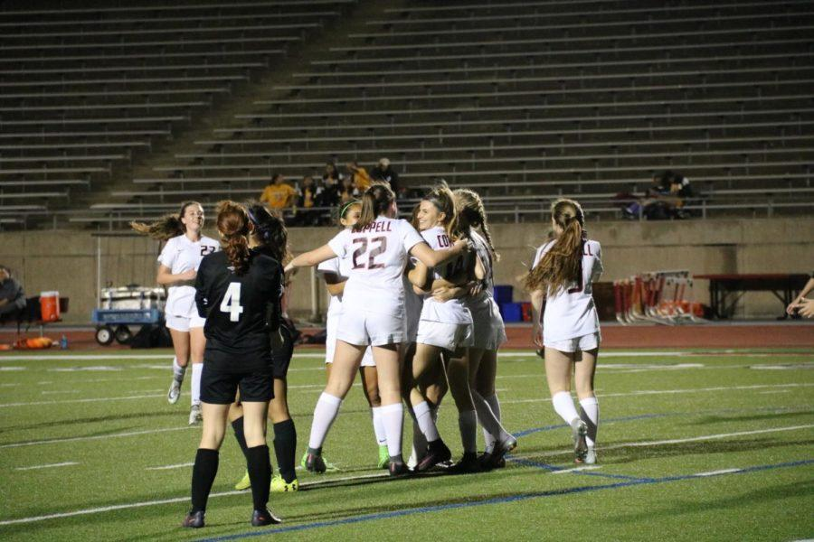 Coppell High School Girls Soccer Varsity celebrate being Distract Champions after their win against the Richardson Eagles at Buddy Echols Field. The Cowgirls won the game against the Eagles 6-1.