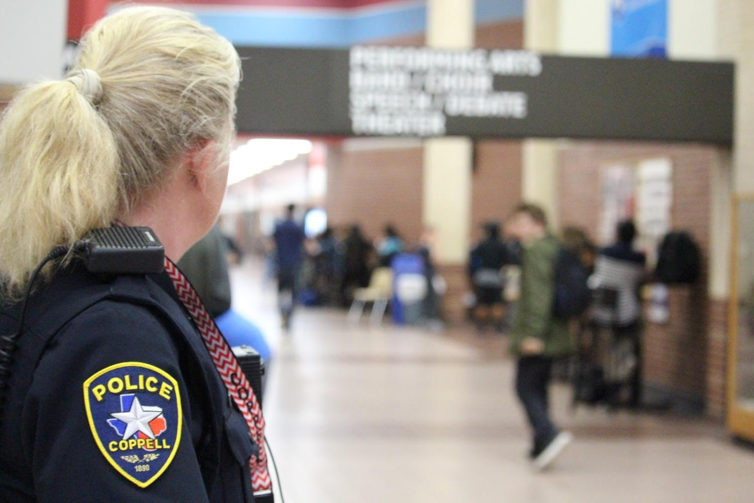 Coppell High School          Student Resource Officer Diane Patterson looks out for students as lunch begins today during sixth period. Having security officers during the school day helps to protect students against any unexpected violence.
