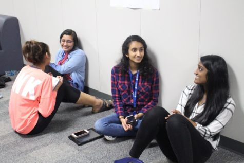 Coppell High School IB junior students Anu Uppal, Karvi Bhatnagar, Dwija Dammanna and Sahana Ramasamy chat in the hallway during sixth period on International Women's Day. International Women's Day is celebrated on March 8 yearly to honor the movement of women's rights in America.