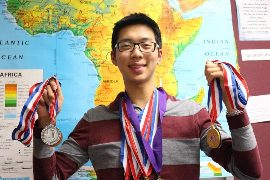 Coppell High School Vincent Lin displays his seven Academic Decathlon (AcDec) medals in B211 on Wednesday afternoon. Lin achieved a 948.1 out of 1,000 overall score in the Academic Decathlon State Competition, the highest overall score in CHS history.