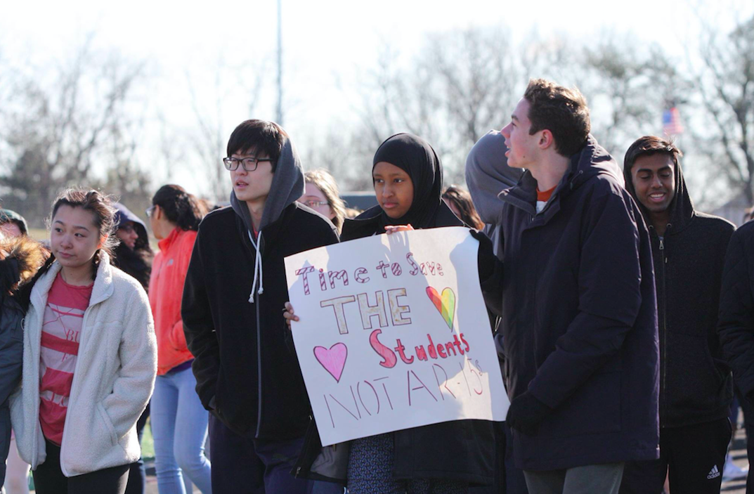 Students at Thomas Jefferson High School for Science and Technology (TJHSST) in Alexandria, Virginia hold signs and stand up for gun restriction. The seniors were not present during the walkout and instead were at the one in Washington, D.C.