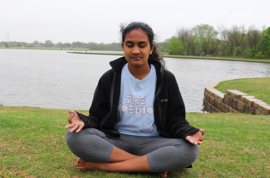 The Sidekick sophomore staff writer Anika Arutla meditates at Andy Brown Park East on Tuesday. Arutla practices Anapana, which is a breathing technique under the form of meditation Vipassana. Meditation has multiple benefits, including sharp focus and reducing anxiety.