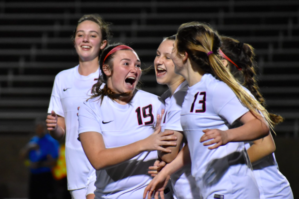 Coppell junior midfielder Shelby Sylvester (no. 19) shows her excitement as the Cowgirls score their fifth goal during the Class 6A Region I bi-district match against Naaman Forest on Thursday night at John Clark Stadium in Plano. The Cowgirls won, 5-0, and advance to play Mesquite Horn on Tuesday in the area playoff.