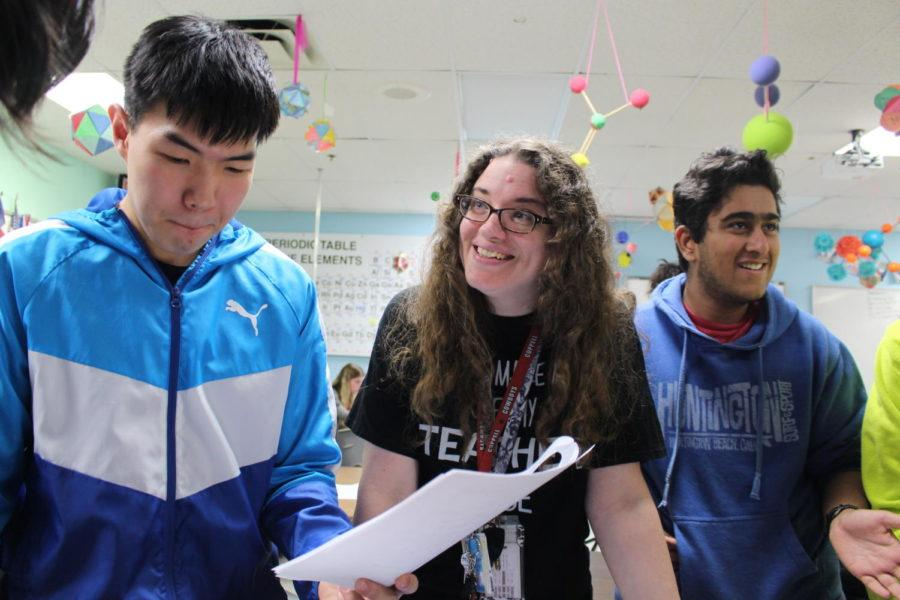 Coppell High School IB Chemistry third period students get help on their test corrections from IB and Honors Chemistry teacher Susan Sheppard on Feb. 9. Students ask questions regarding their test and receive feedback and answers from Sheppard.
