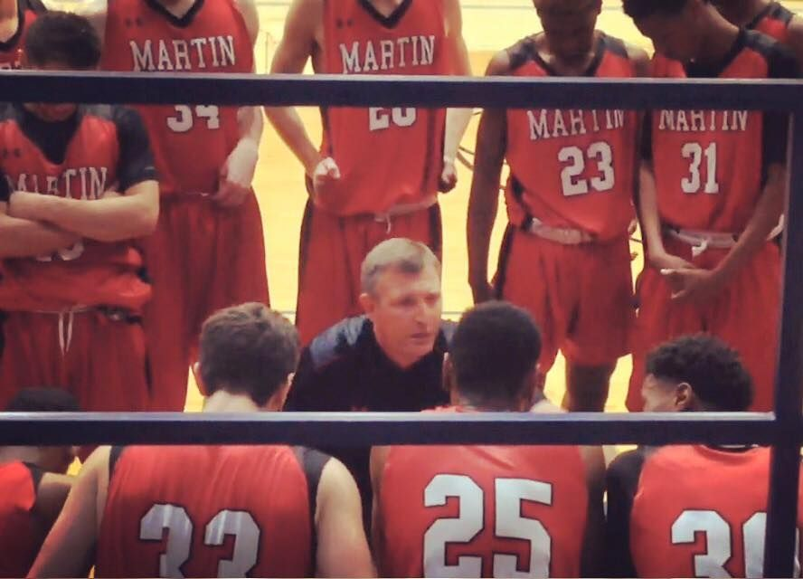 Coach Clint Schnell talks to his Arlington Martin Warriors team during a time out. Schnell has been named the new boys basketball head coach for Coppell High School.