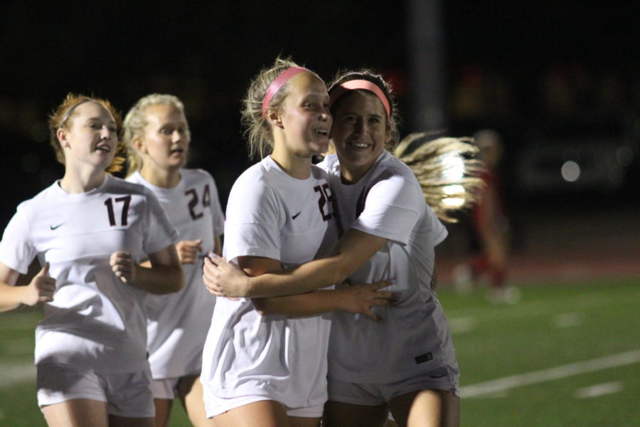 Coppell Cowgirls junior Micayla Weathers (right) and junior defender Mary Ziperman (left) hug as they celebrate the team's fourth goal during the second half of the game on April 3 at Stade Postell Stadium. The Coppell Cowgirls defeated the Mesquite Horn Jaguars 5-0.