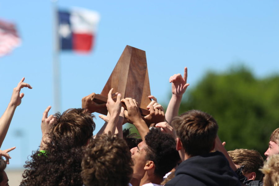 Coppell+Cowboys+players+celebrate+after+winning+the+Region+II+6A+Soccer+Tournament+against+the+Conroe+Tigers+on+April+14+at+Kelly+Reeves+Athletic+Complex+in+Round+Rock.+The+Cowboys+advanced+to+state+after+defeating+the+Tigers+1-+0.+Photo+by+Karis+Thomas