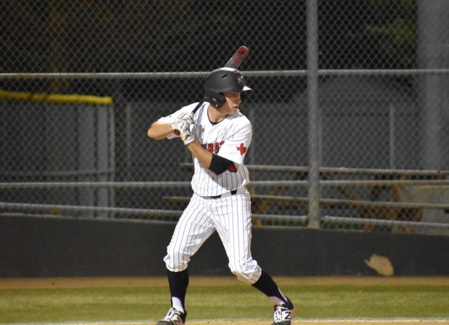 Coppell senior designated hitter Reid Valentine who is sports copy editor for The Sidekick, entered high school with a back injury resulting from years of playing baseball. Valentine's stress fracture gave him a deeper appreciation for playing the game he loves.  Photo by Mari Pletta.