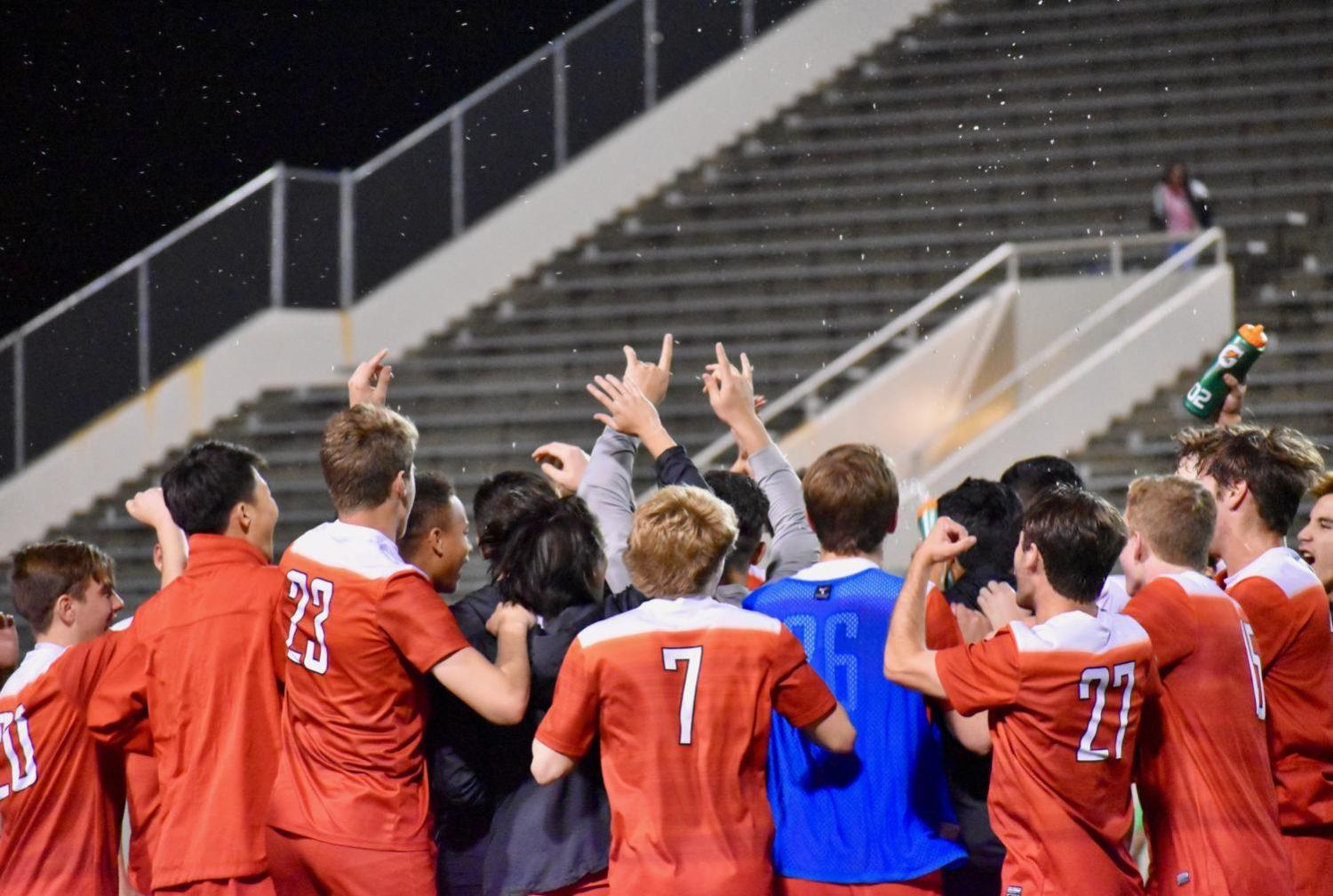 After defeating Mesquite, players huddle up and celebrate their victory after the game at the Wildcat-Ram Stadium. The Coppell Cowboys took home a victory with a score of 3-0, which leads them to the upcoming Regional Tournament in Round Rock next weekend.