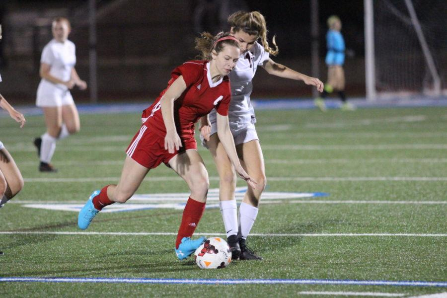Coppell Cowgirls senior defender Addison Ramirez tries to steal the ball from Mesquite Horn Jaguars senior defender Felicia Bell during the second half of the game on April 3 at Stade Postell Stadium. The Coppell Cowgirls defeated the Mesquite Horn Jaguars 5-0.