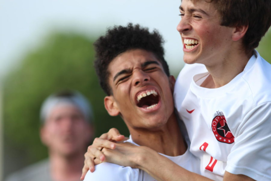 Coppell Cowboys senior center forward Francisco Redondo and junior forward Joe Ruedi celebrate after the Cowboys scored a goal during the second period of overtime at Kelly Reeves Athletic Complex in Round Rock this afternoon. The Coppell Cowboys defeated the Spring Woods Tigers 1-0 in the Region II 6A Soccer Tournament. Photo by Karis Thomas