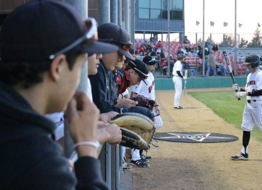 The+Coppell+High+School+varsity+baseball+team+lines+up+in+the+dugout+to+watch+the+first+inning+of+Friday+nights+game+against+the+Skyline+Raiders.+Coppell+pulled+out+a+12-2+win+over+Skyline+at+Cowboy+Field.+