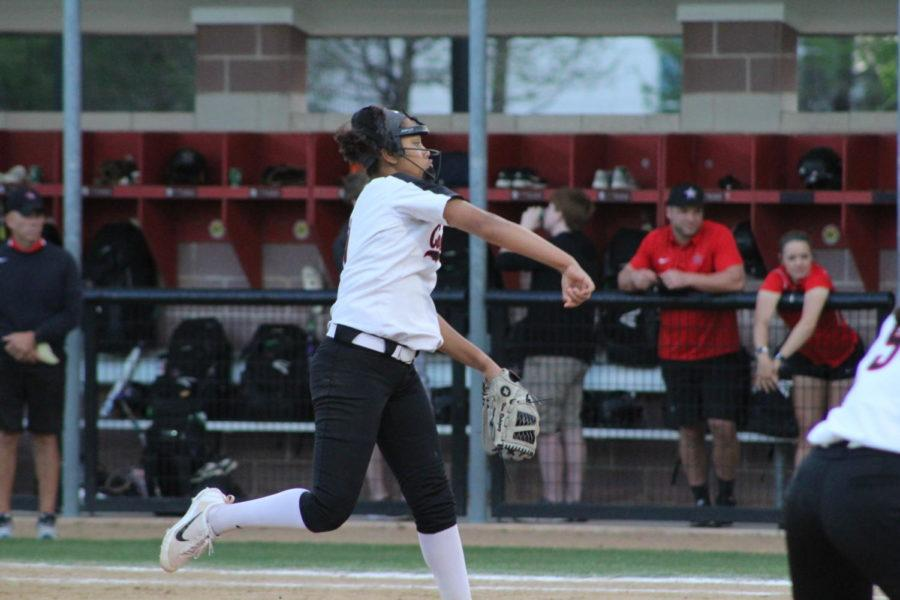 Coppell High School junior right handed pitcher Nora Rodriguez pitches the ball to the opposing team player at the CISD Baseball/Softball Complex on Tuesday night. The Cowgirls varsity softball team won Tuesday night's home conference game against the Berkner Lady Rams with a score of 2-1.