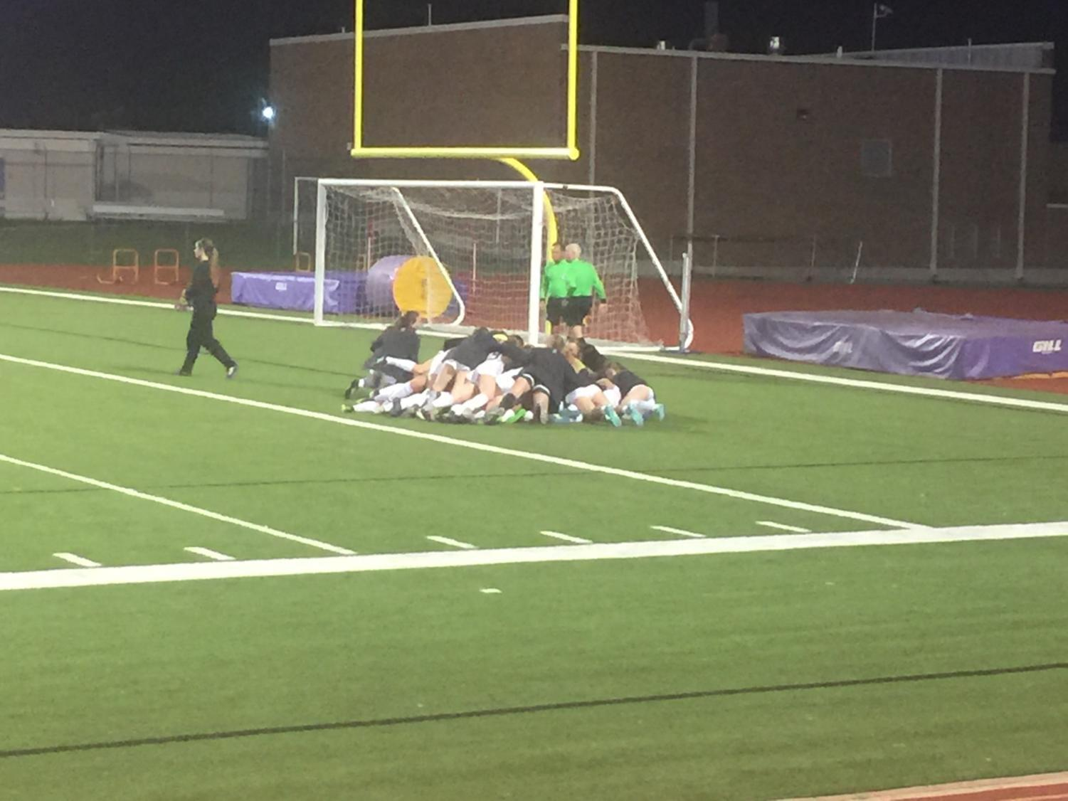 The Coppell girls soccer team celebrate it's Class 6A Region II quarterfinal victory on Thursday night against Sachse. After playing 20 minutes of overtime, the Cowgirls won 4-3 during penalty kicks at Richardson's Eagle-Mustang Stadium.