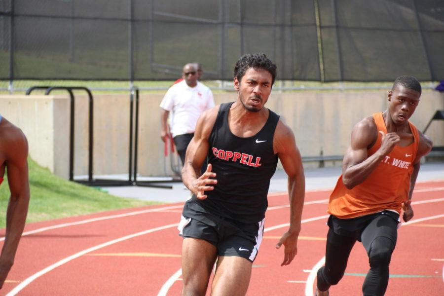 Coppell High School sophomore Samir Thota represents the Cowboys in the 200 meter run at Buddy Echols Field on Friday during eighth period. Thota placed sixth with a time of 23.00.