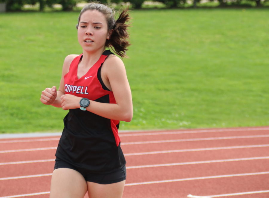 Coppell High School sophomore Daniela Alfaro Flores represents the Cowboys in the 1600 meter run at Buddy Echols Field on Friday during eighth period. Flores placed third place with a time of 5.56.63, earning Coppell 6 points.