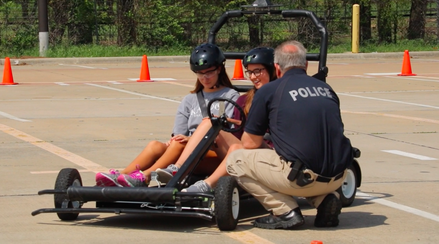 Seniors+Anna+Wilcox+and+Lauren+Granado%2C+students+in+Coppell+High+School%E2%80%99s+forensics+science+teacher+Rebecca+Wheatley%E2%80%99s+class%2C+participated+in+a+Simulated+Impaired+Driving+Experience+%28SIDE%29+today.+This+is+the+third+year+of+the+simulation+which+is+presented+in+partnership+with+the+Coppell+Police+Department.+
