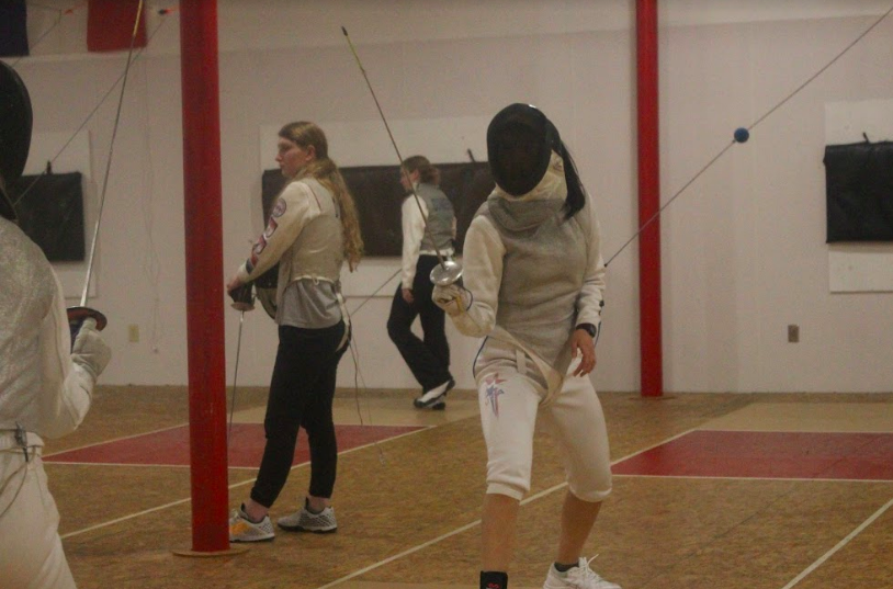 Coppell High School junior Grace Hao stands on guard during fencing practice on April 2 at the Fencing Institute of Texas. Hao has been fencing for eight years and has committed to the University of Pennsylvania to continue her fencing career.