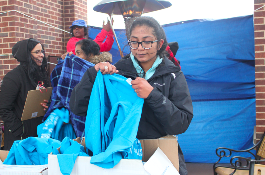 Coppell High School sophomore Athira Suresh folds shirts during the Imagine Beyond Walkathon that took place on April 7 at Andy Brown Park East. The funds raised from the Walkathon go towards the Autism Treatment Center in Dallas.