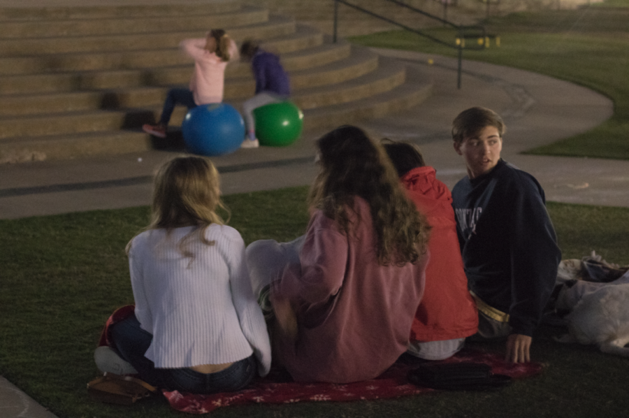"""CHS students sit together to watch a screening of """"Rapunzel"""" on Saturday evening from 6 - 10 p.m. at the Town Center Plaza to fundraise for A Night for Nepal. A Night for Nepal is an organization working to raise money for the reconstruction of schools in Nepal following the devastating earthquake that took place three years ago."""