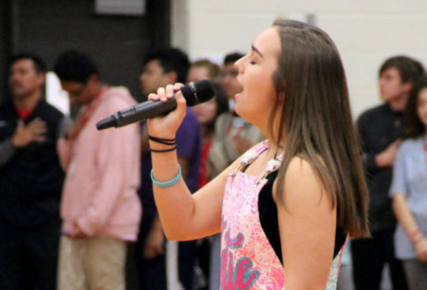 Coppell+High+School+senior+Katie+Love+sings+the+national+anthem+at+a+pep+rally.+Love+is+among+the+students+looking+to+auditioning+for+an+opportunity+to+sing+at+graduation+and+the+Senior+Awards.