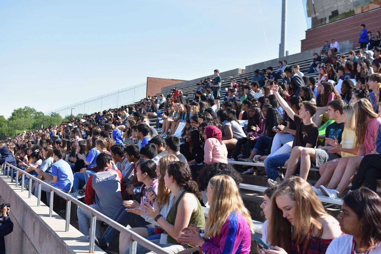 Coppell+High+School+students+walk+out+with+posters+at+the+Coppell+High+School+walkout+today+in+the+track.+The+walkout+was+attended+by+approximately+700+high+school+students+in+support+of+gun+control+and+school+safety.