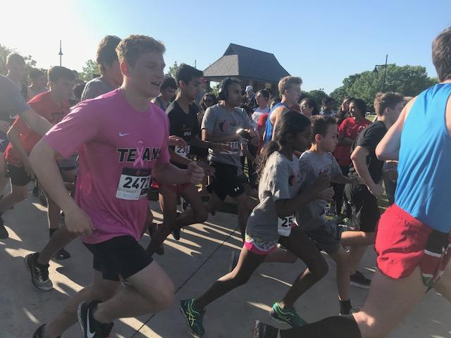 Runners+start+the+5K+at+8%3A30+a.m.+for+the+annual+Coppell+ISD+Education+Foundation+Red+and+Black+Run+to+Fund.+The+Run+to+Fund+took+place+at+Andy+Brown+East+on+Saturday+and+included+a+one+mile+fun+run+and+the+5K.