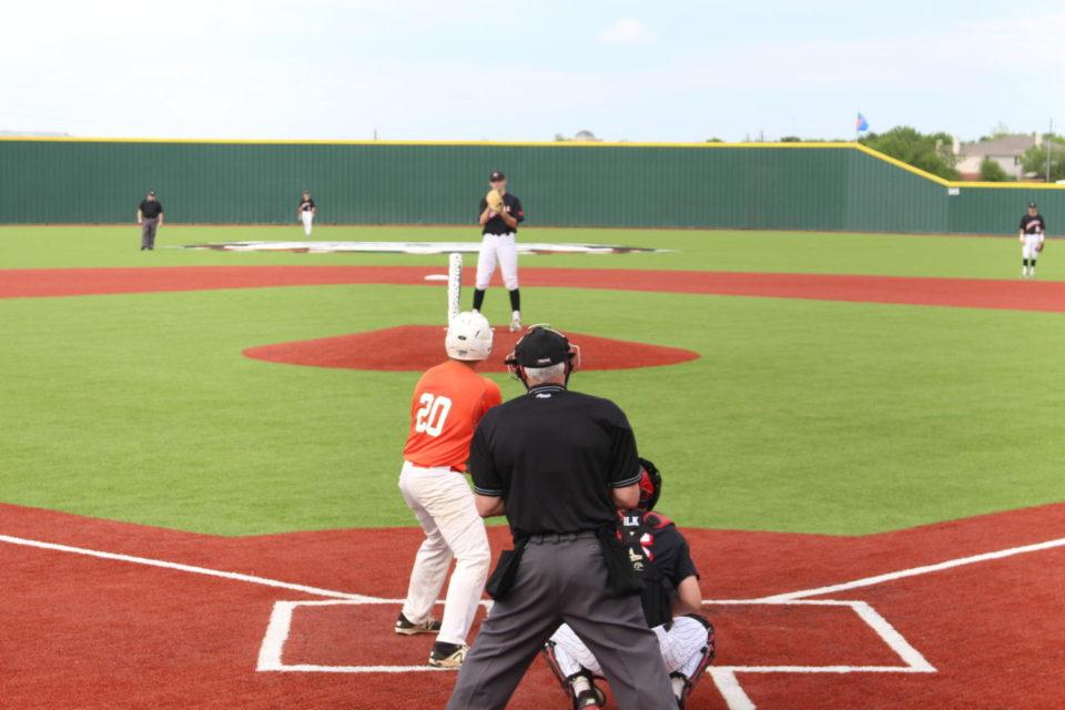 Senior pitcher Rye Gunter faces a Naaman Forest hitter in the bottom of the third inning of Friday's baseball game. The Cowboys shut out the Rangers 11-0 and a no-hitter was thrown by Gunter in the process.