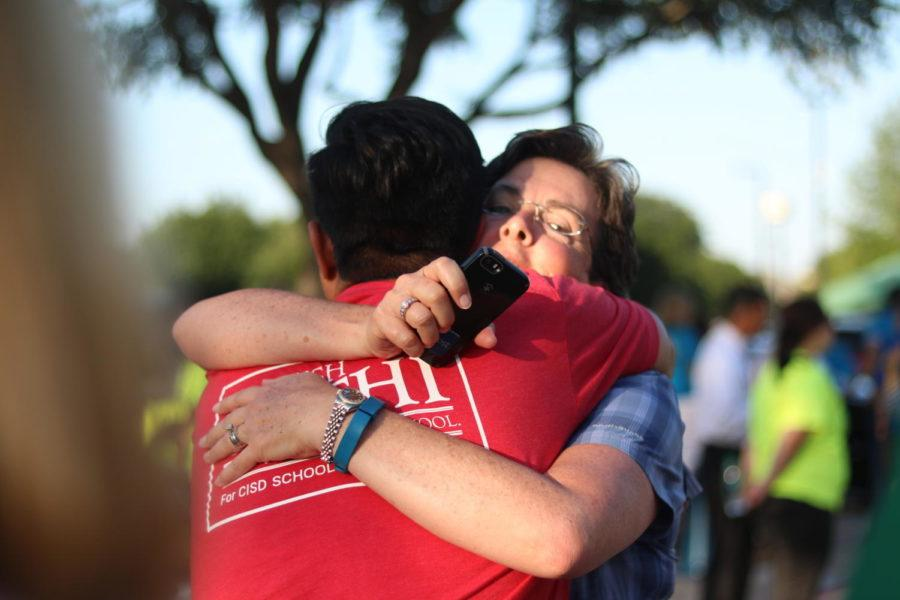 Coppell mayor Karen Hunt and School Board Place 2 candidate Manish Sethi exchange a hug after the early voting results were announced. At the end of the night, Sethi won the election with 68 percent of votes. Photo by Kelly Wei.