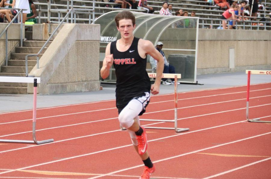 Coppell+High+School+senior+Phillip+Frank+represents+the+Cowboys+in+300+meter+hurdles+at+Buddy+Echols+Field+on+April+6.+Frank+qualified+for+the+Class+6A+track+meet+in+high+jump.