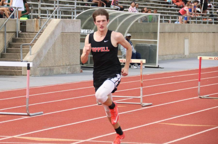 Coppell High School senior Phillip Frank represents the Cowboys in 300 meter hurdles at Buddy Echols Field on April 6. Frank qualified for the Class 6A track meet in high jump.