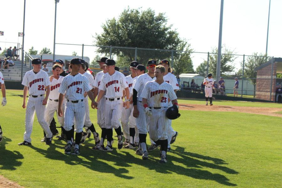 The Coppell baseball team congratulates  junior first baseman Nick Vernars after his home run in the bottom of the sixth inning of Friday's 6-5 loss to Montgomery. The Cowboys season ended on Saturday when Montgomery defeated Coppell, 4-3, to clinch the best-of-3 Class 6A Region I area series.