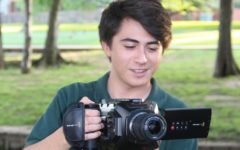 Coppell High School senior John Coffee uses his video camera on May 14. Coffee has had a passion for film since a young age, and is planning to pursue the craft in college.