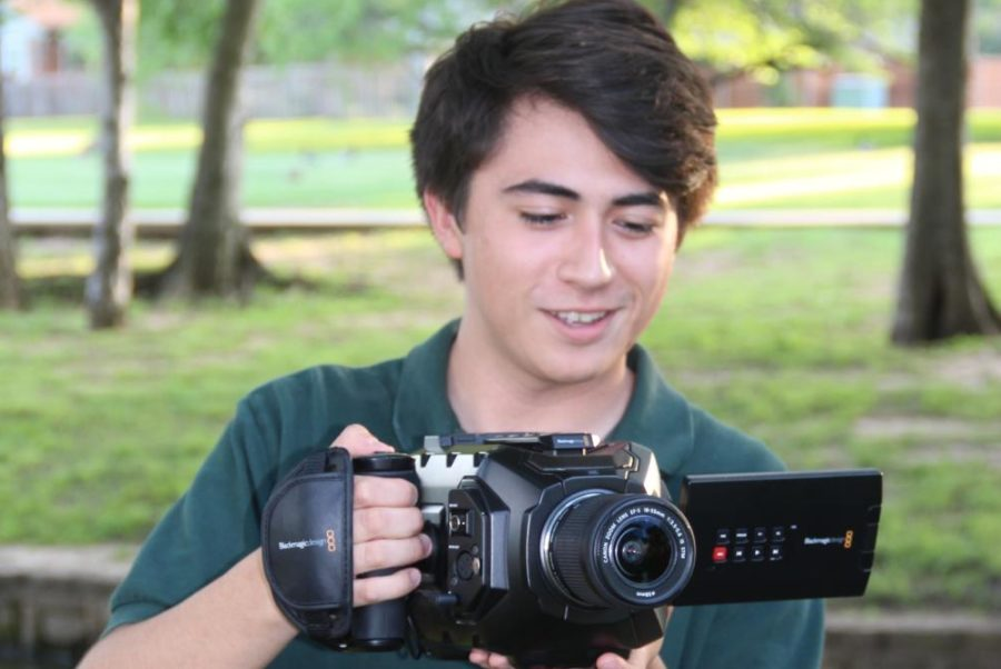 Coppell+High+School+senior+John+Coffee+uses+his+video+camera+on+May+14.+Coffee+has+had+a+passion+for+film+since+a+young+age%2C+and+is+planning+to+pursue+the+craft+in+college.+%0A